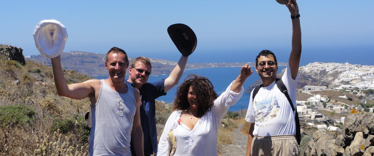 Group of people hiking tour in Santorini